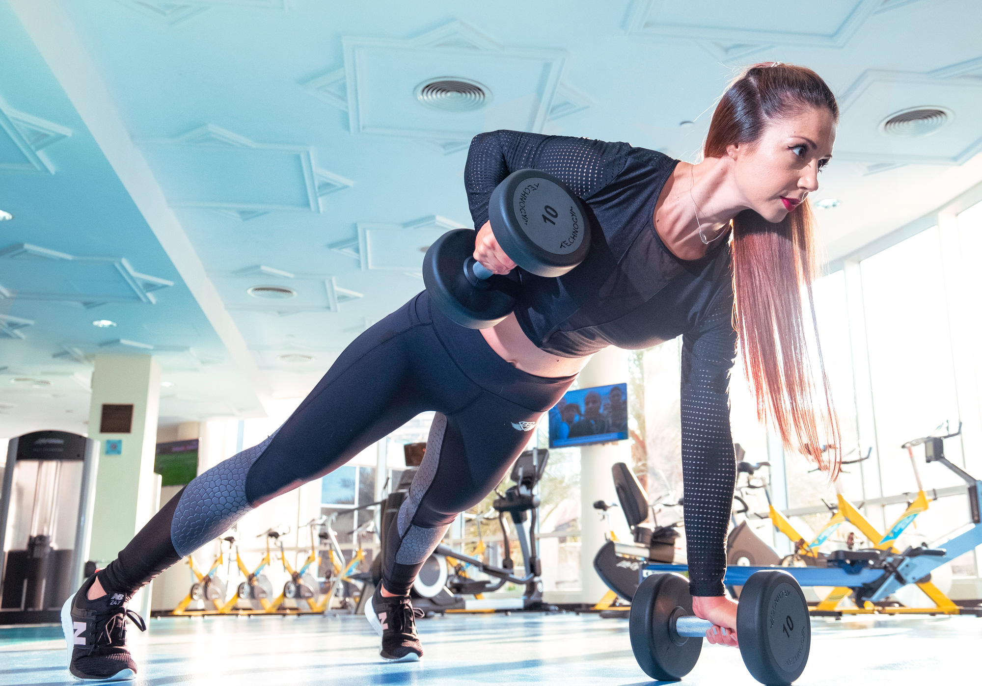 woman-doing-exercise-inside-gym-2247179