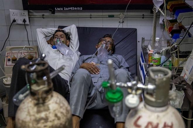 Hai biến chủng SARS-CoV-2 ở Ấn Độ nguy hiểm thế nào? - Ảnh 4.