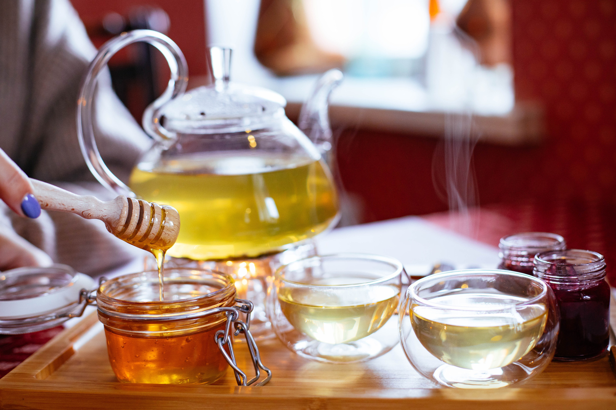 teapot-and-teacups-with-tea-and-honey-on-tray-1872886