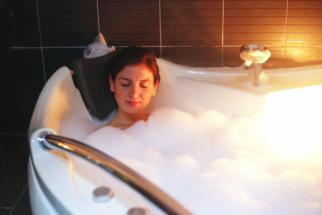 woman-relaxing-in-hot-tub